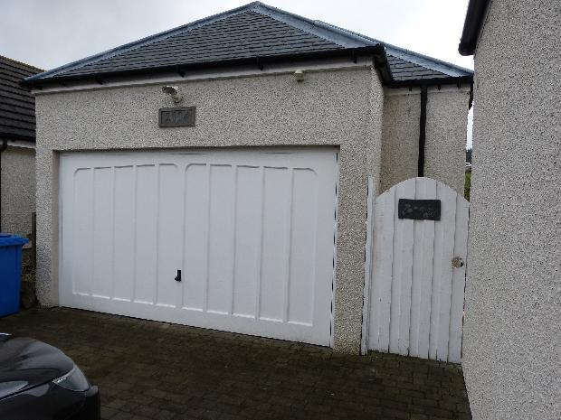 Double Garage with gate into rear garden