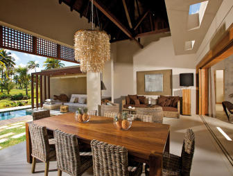 photo of designer luxury open plan beige brown conservatory dining room living room lounge with chandelier and outdoor living