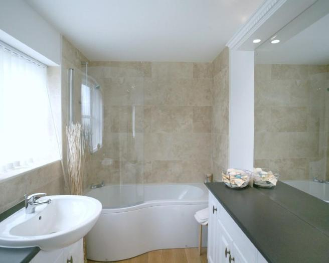 photo of compact blue white marble effect bathroom ensuite ensuite bathroom with bath corner bath