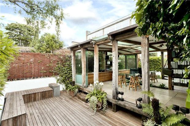 photo of designer conservatory garden with sliding folding doors and decking patio verandah