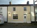 Terraced home in Upper Row, Penywern...