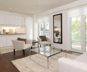 photo of open plan beige white kitchen living room lounge lounge diner lounge/dining area with windows
