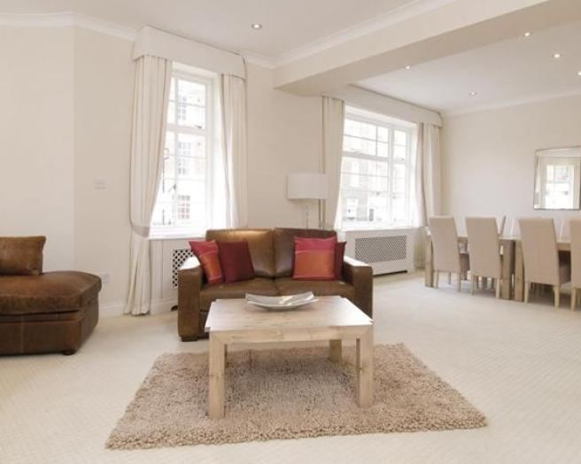 photo of pale beige cream oatmeal white living room with carpet