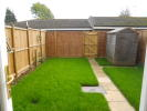 Enclosed rear garden with patio, lawn and shed