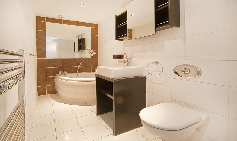 Photo Of Modern Beige Bathroom With Corner Bath Rectangular Tiles