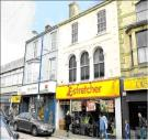 property for sale in Freehold Retail Investment Let to Poundstretcher Ltd at 113 High Street, Rhyl, Clwyd, LL18 1TR