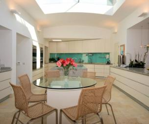 photo of light open plan beige white kitchen