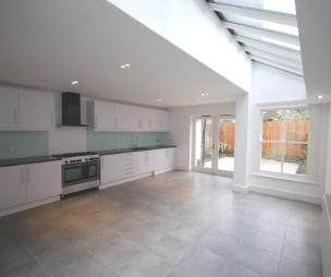 photo of white kitchen kitchen extension with doors & window
