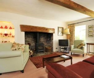 photo of traditional beige brown living room with beams fireplace inglenook fireplace wood burner
