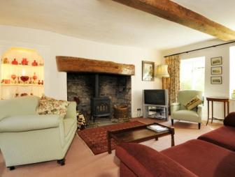 photo of traditional beige brown living room with beams fireplace inglenook inglenook fireplace wood burner and cottage