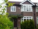 semi detached property in 15 Woodhey Road...