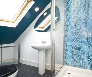 photo of colourful compact blue white bathroom loft conversion with floor tiles flooring shower tiled floor tiles en suite mosaic tiling spotlight