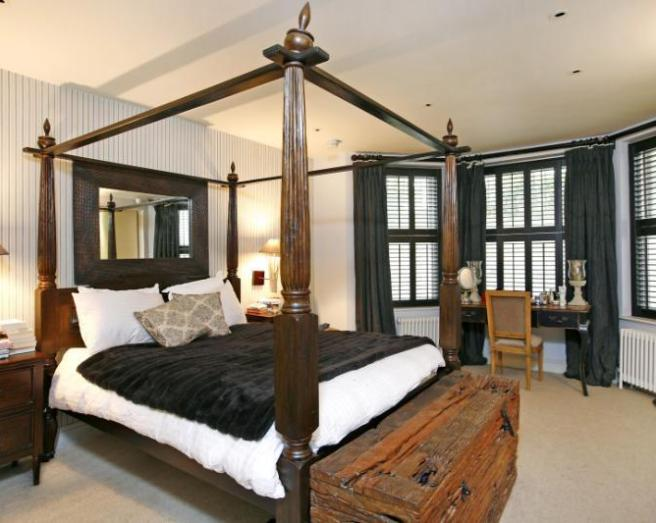 photo of stripes traditional black brown white bedroom with feature wall wallpaper and bed four poster bed furniture treasure chest