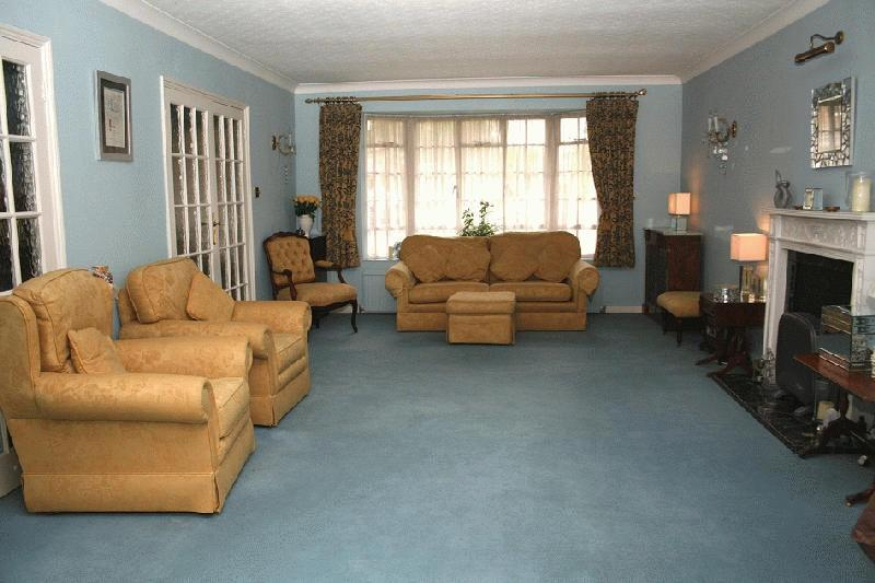 photo of beige blue white living room lounge