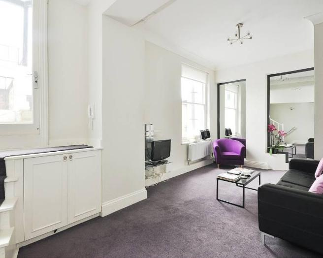 photo of black purple white living room with mirror wall carpet