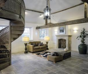 photo of classic contemporary open plan white living room lounge with oak beams original features spiral staircase staircase stairporn stairs