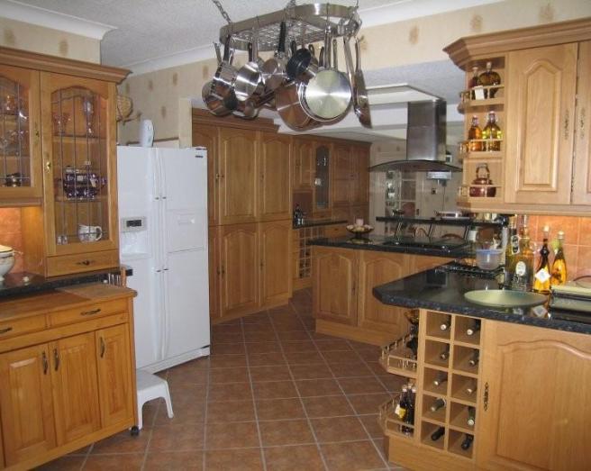 photo of beige brown orange white kitchen with floor tiles flooring tiled floor and extractor hood furniture glazed cabinets wine rack
