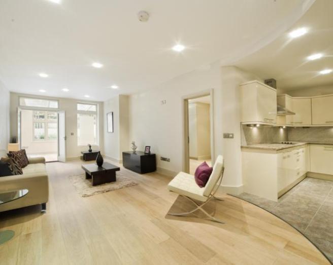 photo of designer open plan white kitchen living room lounge with flooring laminate flooring and chairs designer chair designer furniture furniture