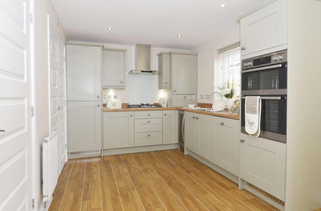 Typical Giles fitted kitchen and dining area