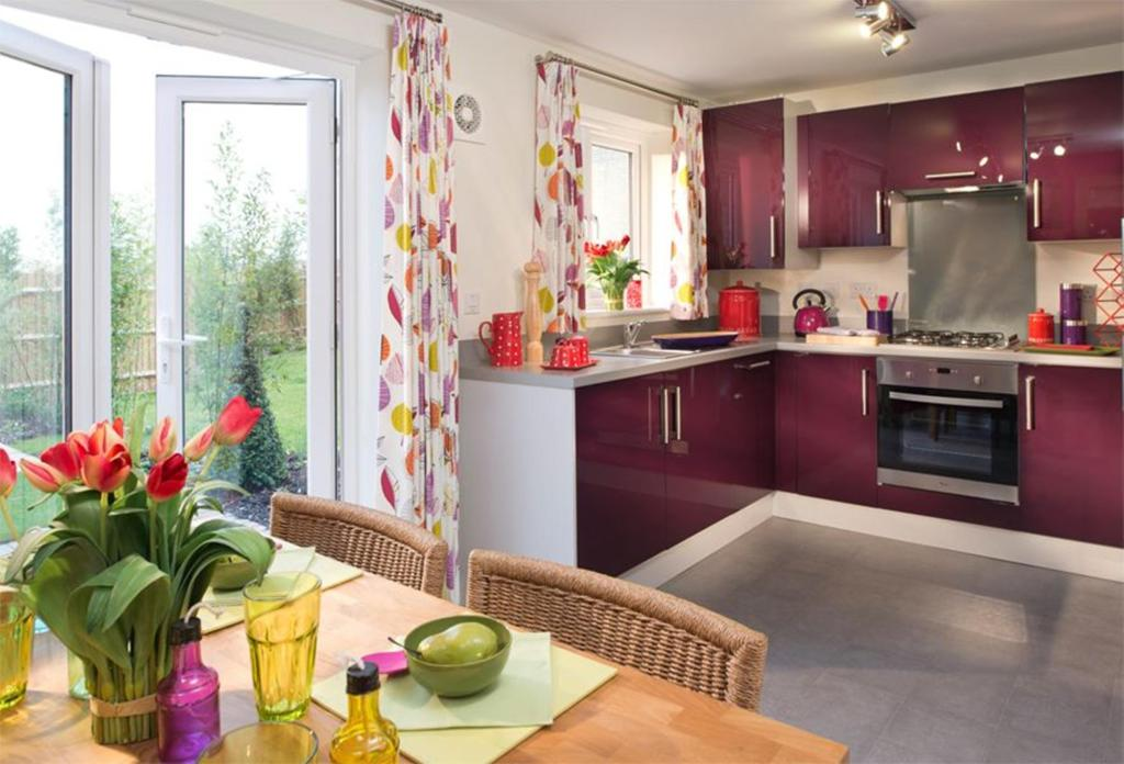 Typical Regis fitted kitchen with breakfast area and French doors to the garden