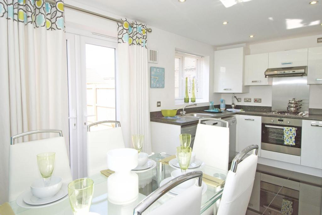Typical Regis fitted kitchen and dining area with French doors