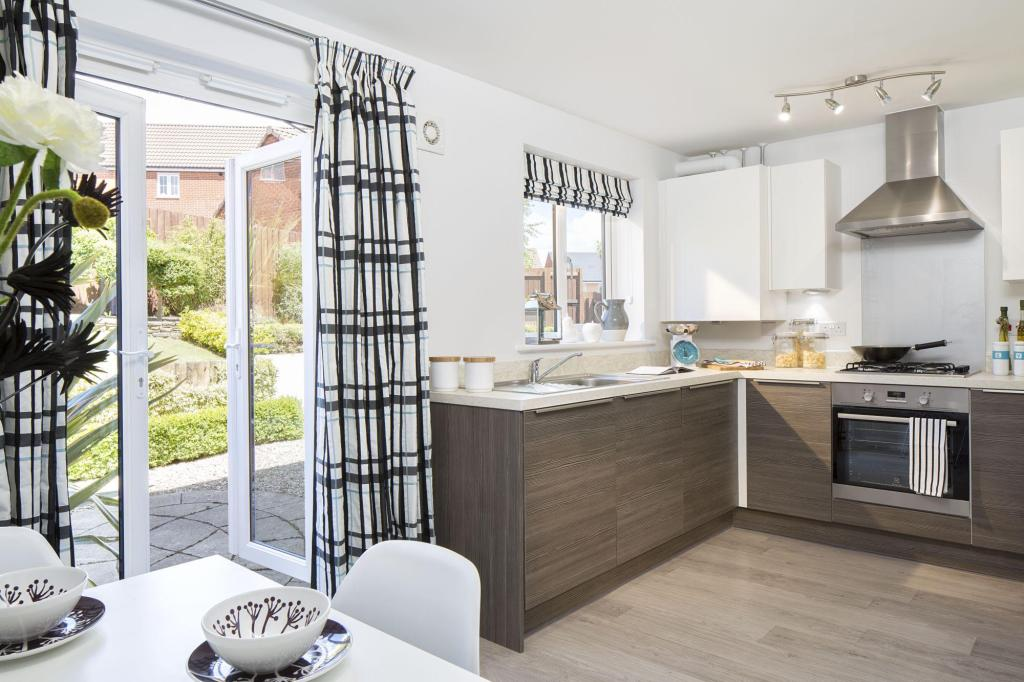 Typical Regis fitted kitchen with dining area