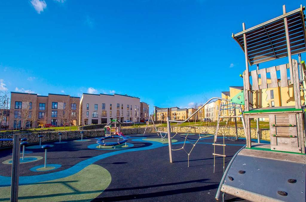 Family homes surrounding a new children`s play area