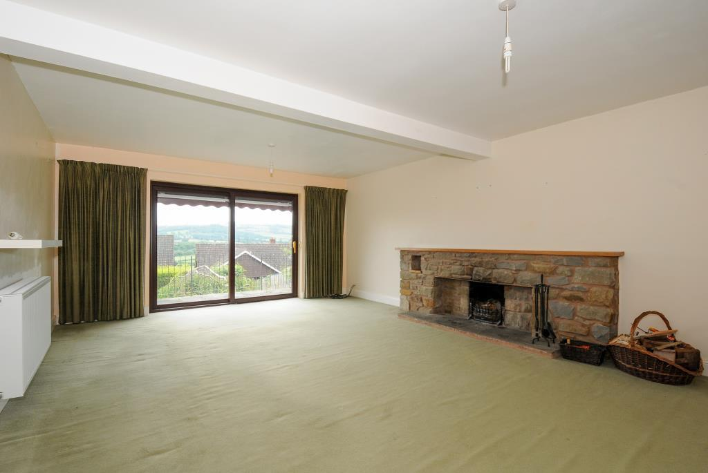 Well proportioned sittaing room with fireplace