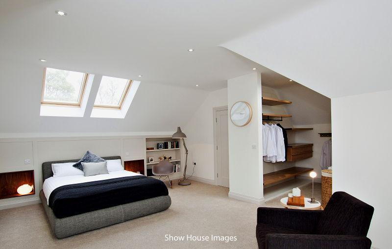 photo of beige white loft conversion with wall clock and wardrobes...