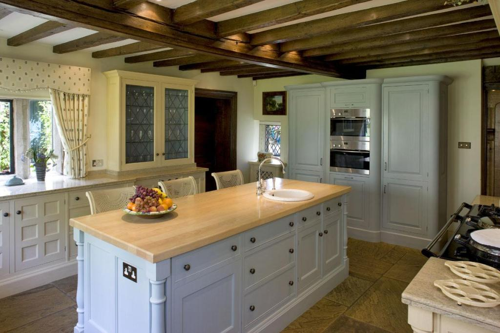 photo of beige brown olive white kitchen with kitchen island