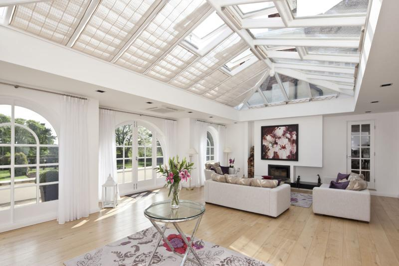 photo of airy light pale beige white conservatory sun room and open space design