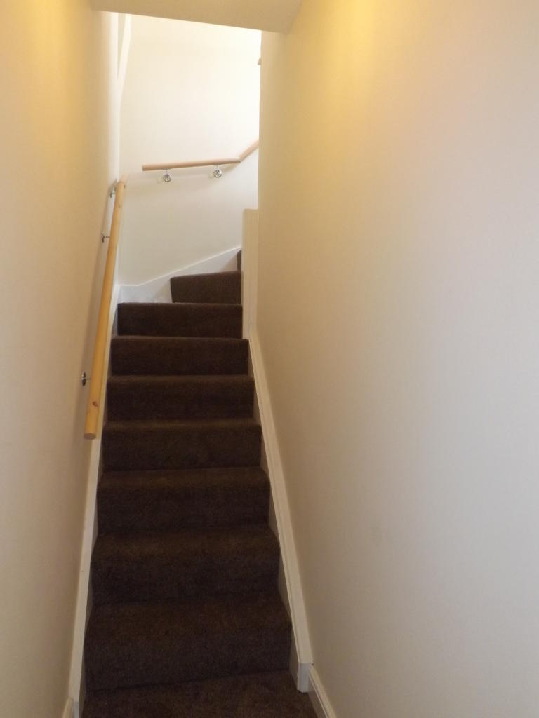 Stairs to attic master bedroom