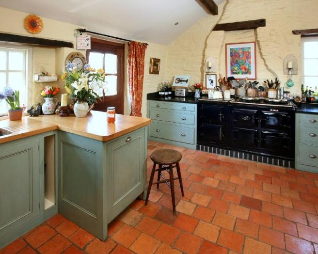 egg blue green orange kitchen with cabinets beams and aga aga oven
