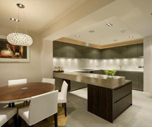 photo of contemporary luxury modern open plan stylish beige dining room kitchen with lighting island