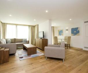 photo of open plan scandinavian beige white living room with flooring laminate flooring