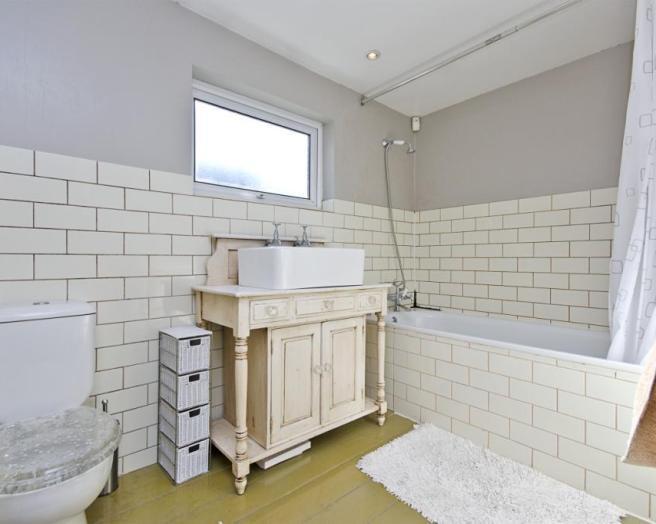 White Brick Tiles Small Bathroom Upholstered Bench Half Glass Shower Room  Bronze Shower Faucet White Oak Bathroom Door