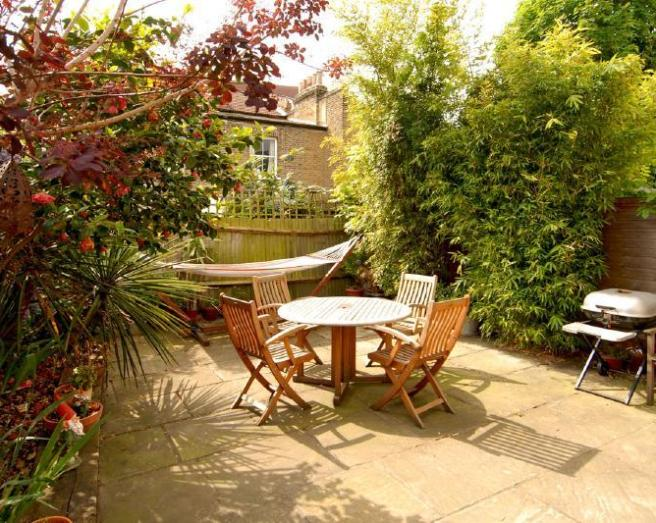 photo of garden study with plants and hammock outdoor furniture patio patio area urban garden