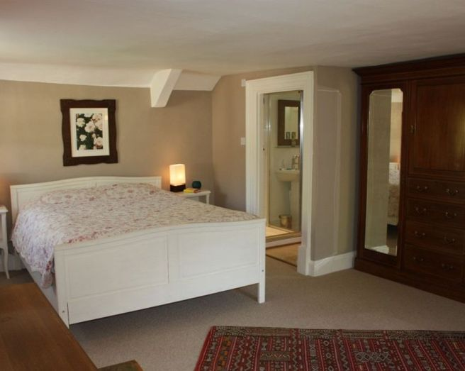 photo of neutral beige brown bedroom with carpet carpeted