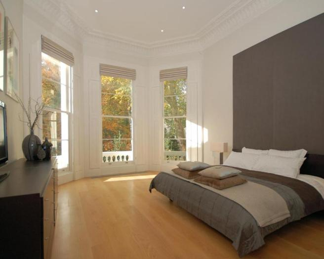 Bay window design ideas photos inspiration rightmove for Brown and cream bedroom ideas