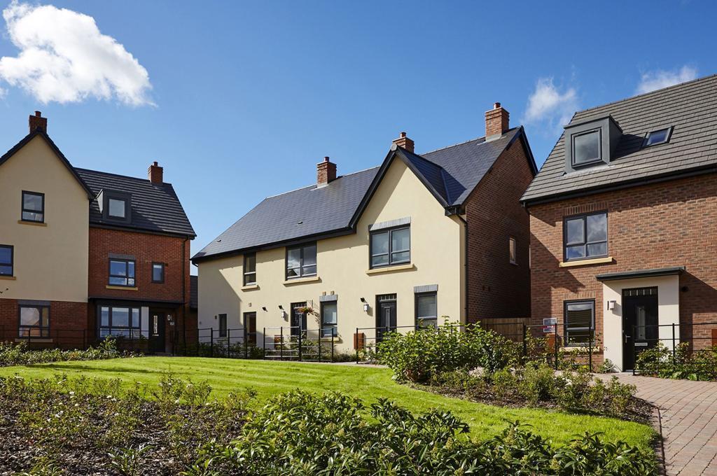 Street scene of family homes in Lawley Village, Telford