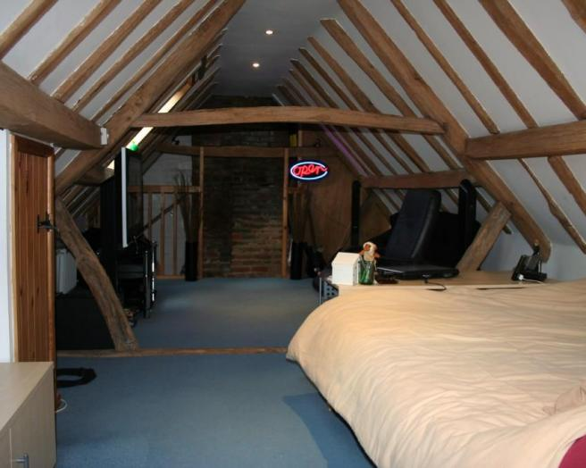 photo of blue attic attic conversion bedroom loft bedroom loft conversion loft room with real beams wooden beams neon and bed double bed furniture