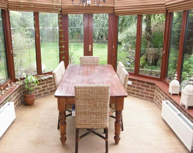photo of beige brown pink white conservatory