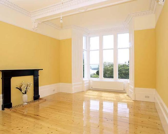 photo of beige orange with bay window feature fireplace fireplace polished wooden floor
