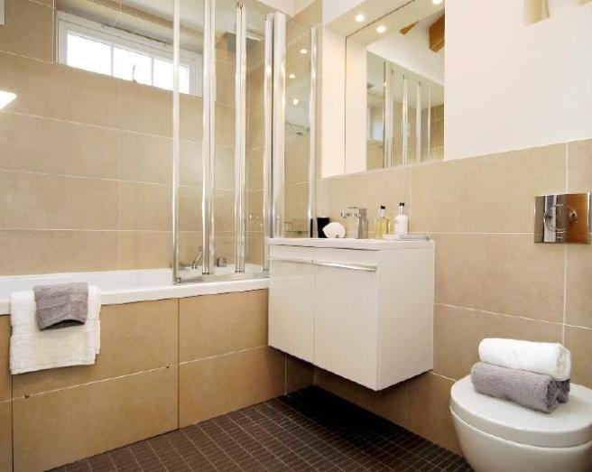 Simple Modern Beige Brown Stone Bathroom With Floating Sink Large Tiles Tiles