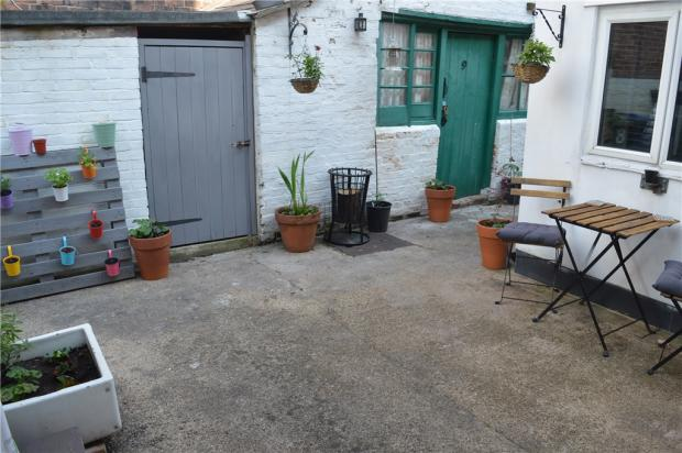 Courtyard And Storage Shed