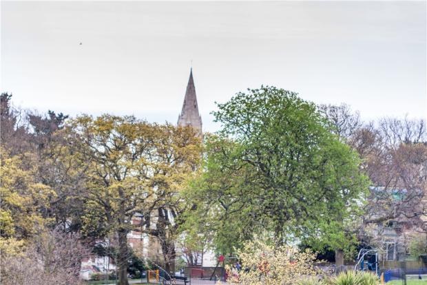 View across Anglesea Gardens to church on Pevensey Road