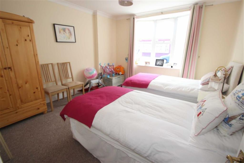 FRONT BEDROOM ONE