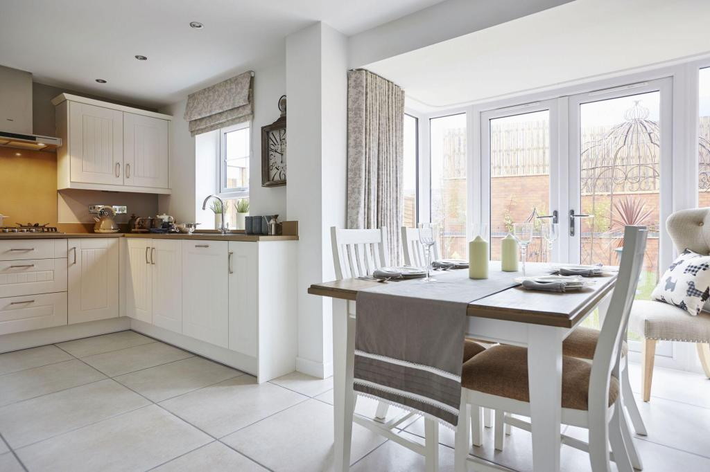 Typical Tetbury fitted kitchen and dining area with glazed bay and French doors