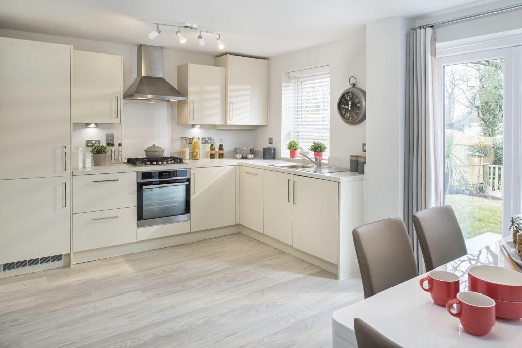 Typical Finchley kitchen and family area with glazed bay and French doors
