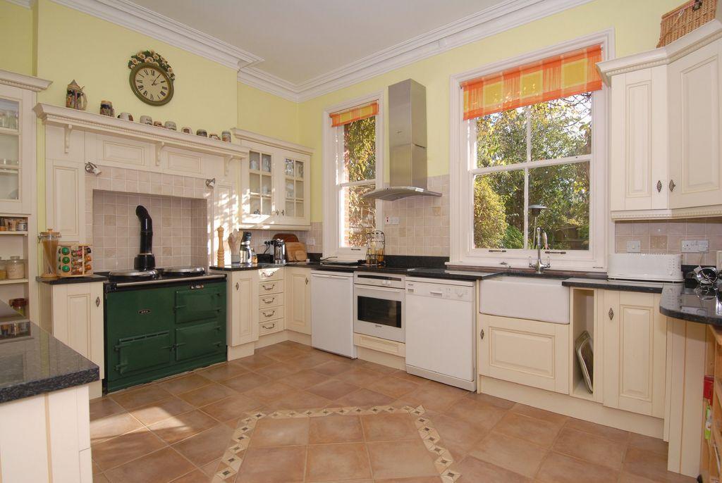 photo of beige kitchen with floor tiles flooring tiles
